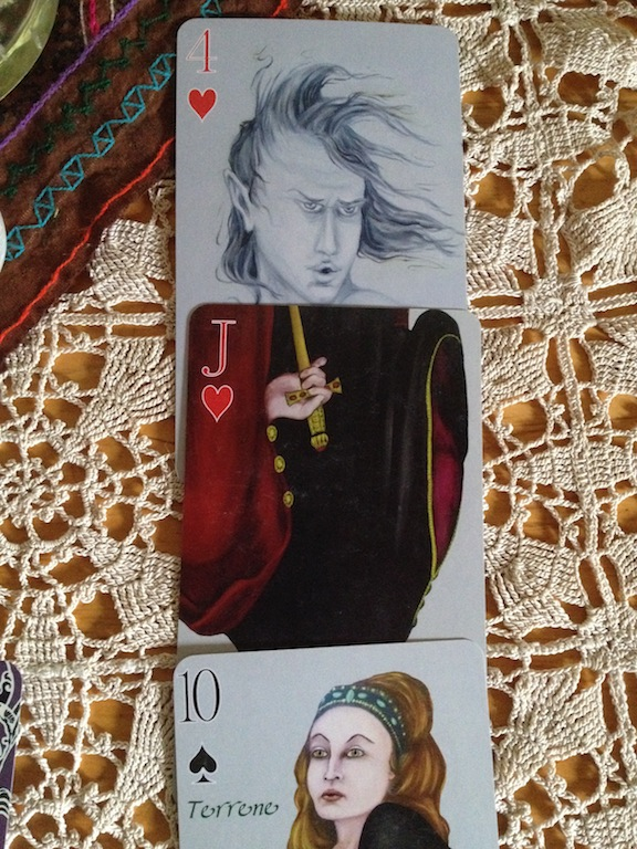 Close up of cards drawn  for Forecast. 4 Hearts, Jack of Hearts, Terrene. From Alchemy Edition Deck.